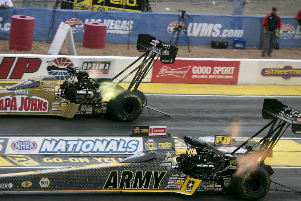 Top Fuel drivers Leah Pritchett, left, and Tony Ҕhe SargeӠSchumacher race during the National Hot Rod Association qualifying sessions at The Strip at Las Vegas Motor Speedway on Friday ...