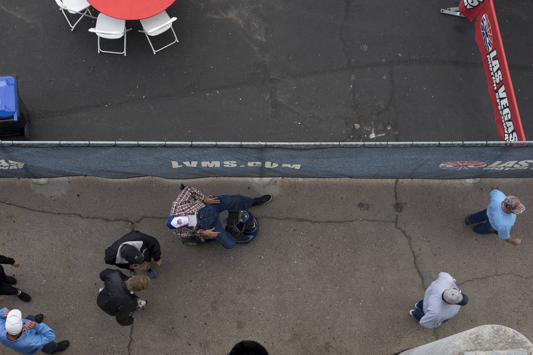 Fans make their way though the concourse of The Strip at Las Vegas Motor Speedway during National Hot Rod Association qualifying session on Friday, March 31, 2017, in Las Vegas. (Bridget Bennett/L ...