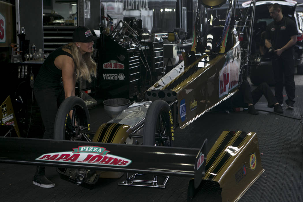Top Fuel racer Leah Pritchett works on her vehicle during the National Hot Rod Association qualifying sessions at The Strip at Las Vegas Motor Speedway on Friday, March 31, 2017, in Las Vegas. (Br ...