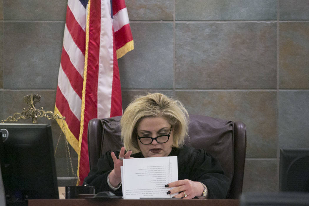 District Judge Michelle Leavitt pages through papers prior to the reading of Javier Righetti's sentencing at the Regional Justice Center on Tuesday, March 21, 2017, in Las Vegas. Righetti was sent ...