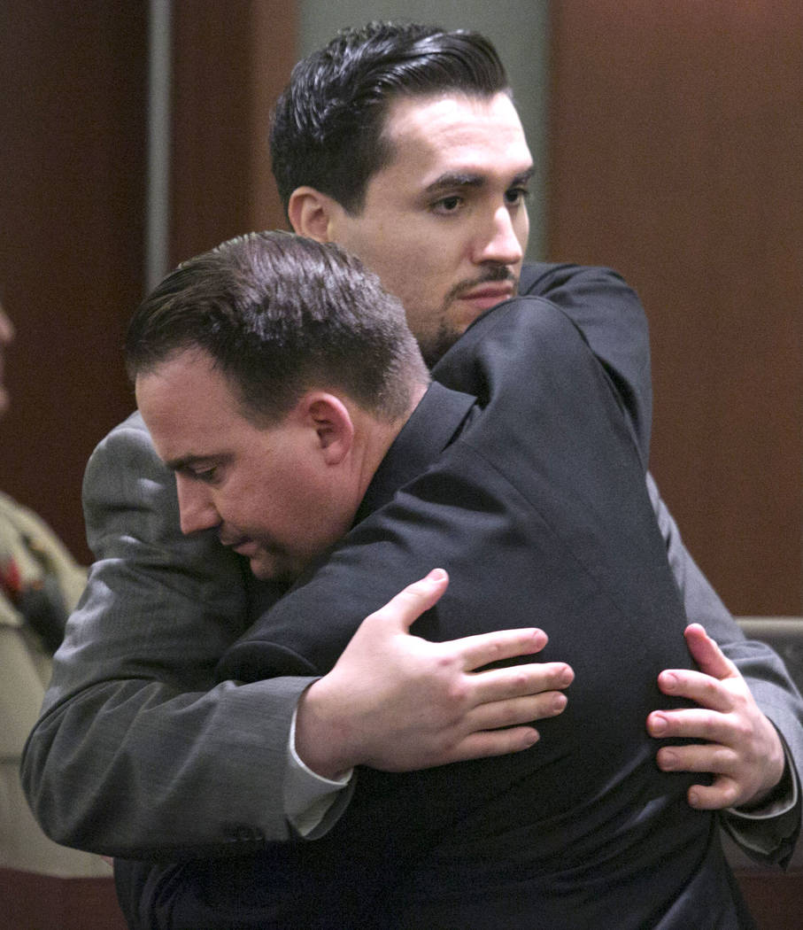 Javier Righetti, left, hugs his defense attorney Ryan Bashor at the Regional Justice Center in Las Vegas on Tuesday, March 21, 2017,  after being sentenced to death for rape and murder of 15-year- ...