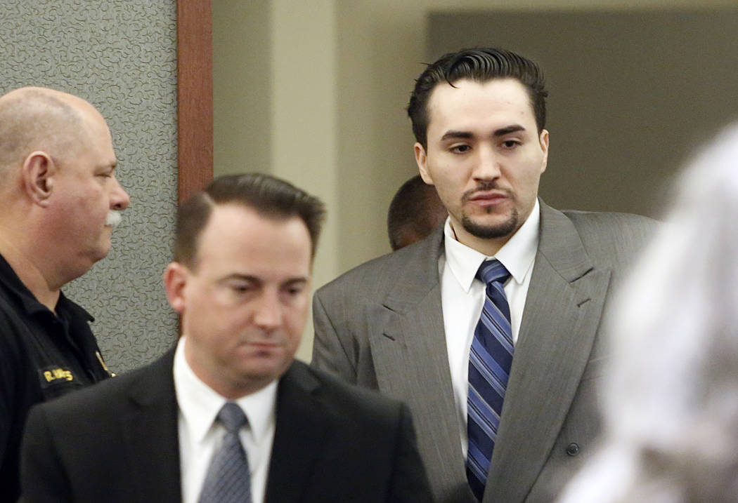 Javier Righetti, right, and his defense attorney Ryan Bashor enter the courtroom at the Regional Justice Center on Tuesday, March 21, 2017, during the penalty phase of Rightetti's murder trial in  ...