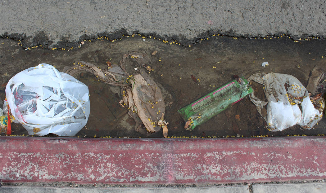Plastic bags and other garbage line the street outside the Nevada Division of Parole and Probation building in Las Vegas, Tuesday, March 21, 2017. If Assembly Bill 344 is passed, it would phase ou ...