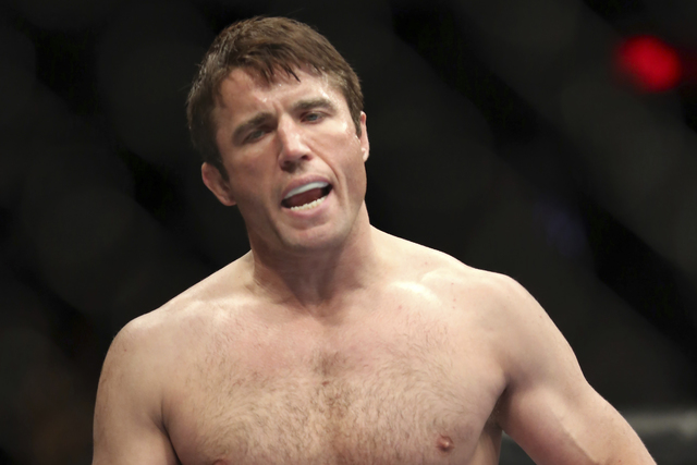 In this April 27, 2013, file photo, Chael Sonnen is reacts before his UFC 159 Mixed Martial Arts light heavyweight title bout against Jon Jones in Newark, N.J. (Gregory Payan, File/AP)