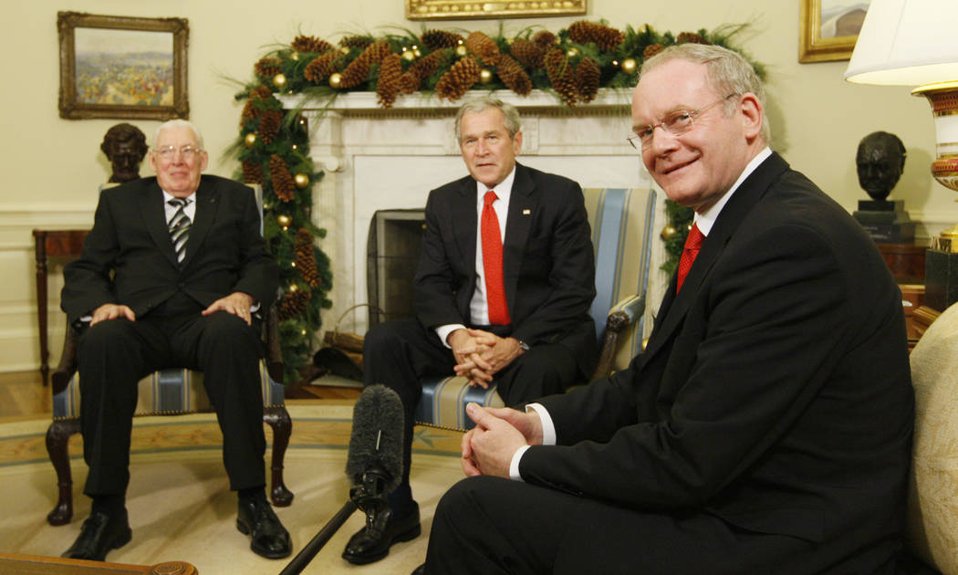 This is a Friday, Dec. 7, 2007 file photo of President Bush, center, as he meets with Ian Paisley, Ireland's first minister, left, and Martin McGuinness, Ireland's first deputy minister, in the Ov ...