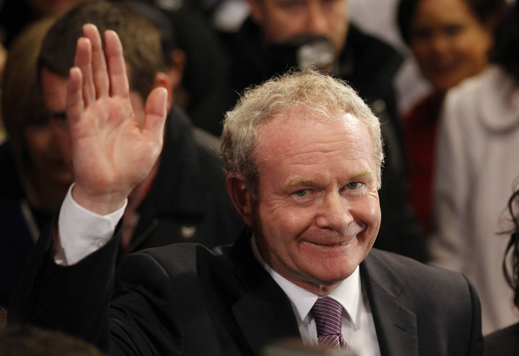 This is a Friday, Oct. 28, 2011  file photo of Sinn Fein's Martin McGuinness as he waves to the media while waiting to hear the results in the first count in the  presidential election at Dublin C ...