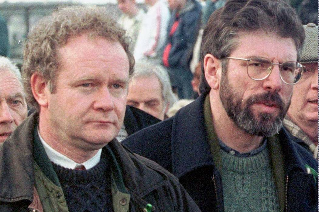 A Feb. 1, 1998, file photo of Martin McGuinness, the Sinn Fein Chief Negotiator, left, and Sinn Fein's president Gerry Adams as they participate in the Bloody Sunday anniversary march in Londonder ...