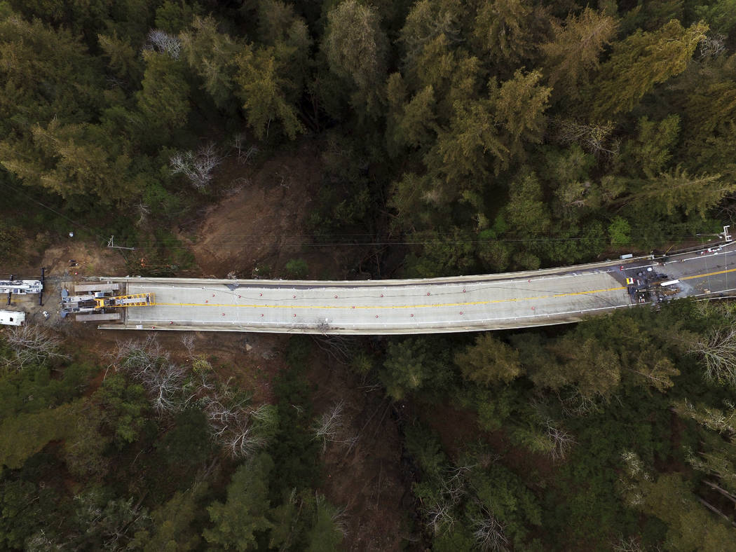In this March 8, 2017, file photo, Pfeiffer Canyon Bridge on Highway 1 is closed due to damage from storms in Big Sur, Calif. Residents are adjusting after the bridge on the Central California coa ...