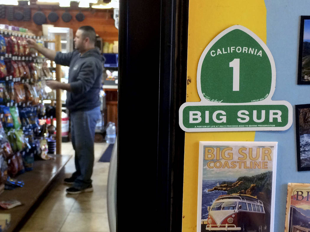 In this March 16, 2017, photo, a worker stocks shelves at Big Sur Deli in Big Sur, Calif. The deli is one of the only businesses open in town on the south side of the bridge closure on Highway 1.  ...
