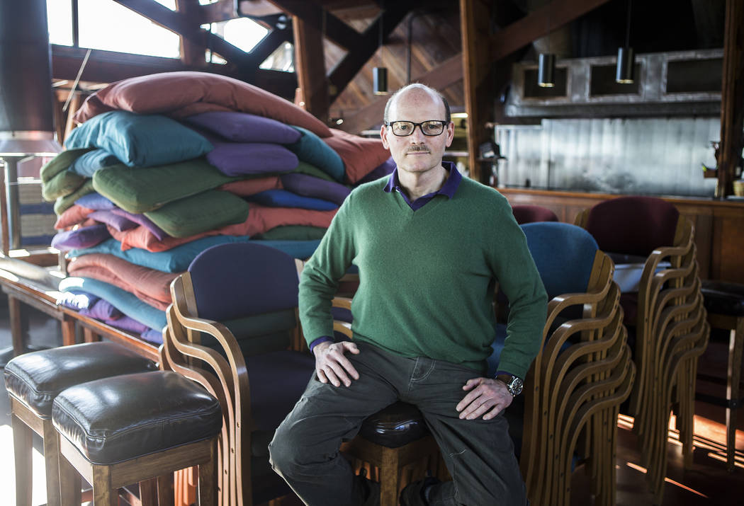 In this March 8, 2017, photo Kirk Gafill, general manager of Nepenthe, sits among piles of chairs and cushions at the closed restaurant in Big Sur, Calif. Residents are adjusting after a bridge on ...