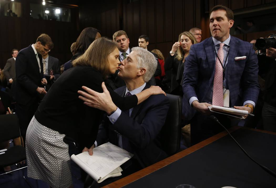 U.S. Supreme Court nominee judge Neil Gorsuchkisses his wife Marie Louise during a break in his testimony at his Senate Judiciary Committee confirmation hearing on Capitol Hill in Washington, U.S. ...