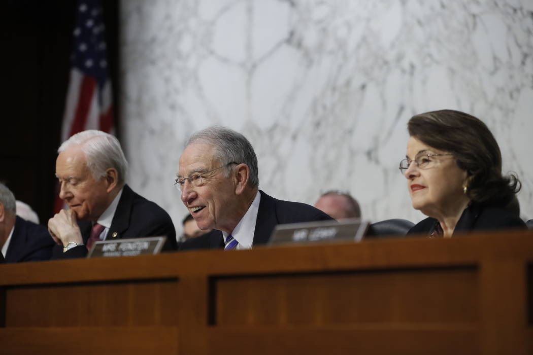 Senate Judiciary Committee Chairman Sen. Charles Grassley, R-Iowa, center, flanked by the  committee's ranking member Sen. Dianne Feinstein, D-Calif., right, and Sen. Orrin Hatch, R-Utah, speaks o ...