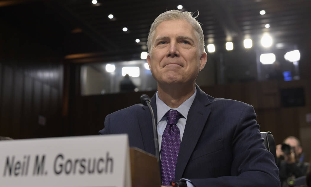 Supreme Court Justice nominee Neil Gorsuch prepares to testify on Capitol Hill in Washington, Tuesday, March 21, 2017, at his confirmation hearing before the Senate Judiciary Committee. (Susan Wal ...