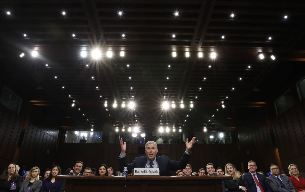 Supreme Court Justice nominee Neil Gorsuch gestures as he speaks on Capitol Hill in Washington, Tuesday, March 21, 2017, during his confirmation hearing before the Senate Judiciary Committee. (AP  ...