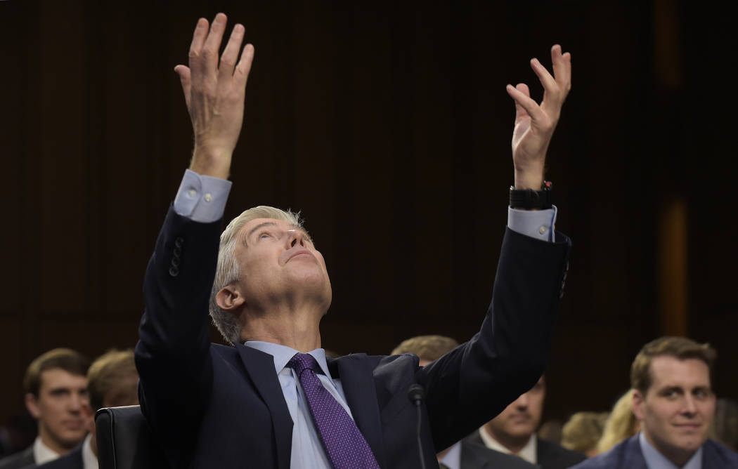 Supreme Court Justice nominee Neil Gorsuch talks about playing basketball with former Supreme Court Justice Byron White as he testifies on Capitol Hill in Washington, Tuesday, March 21, 2017, duri ...
