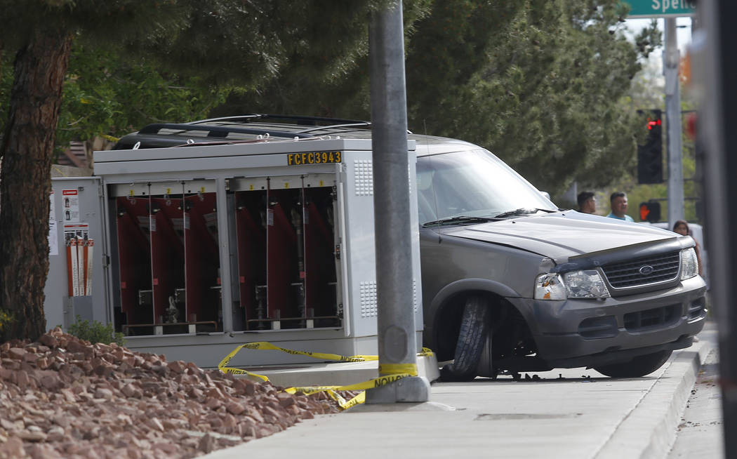 A car smashed into a lightbox near the intersection of Spencer St. and Pyle Ave. on Tuesday, March 21, 2017, in Las Vegas. (Christian K. Lee/Las Vegas Review-Journal) @chrisklee_jpeg