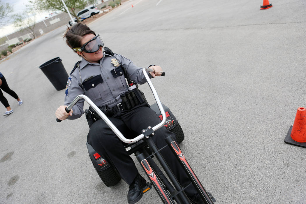 "Nevada Highway Patrol Trooper Chelsea Stuenkel takes part in a mock field sobriety test wearing ""pot"" goggles at the NHP headquarters in Las Vegas, Tuesday, March 21, 2017. (Elizabeth Brumley/Las  ..."