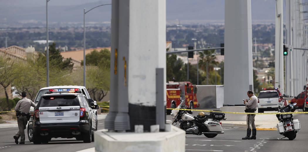 Las Vegas Metropolitan Police Officers secure an area after a 20-foot box truck containing chemicals tipped over near the intersection of Cheyenne Ave and North Grand Canyon Drive on Tuesday, Marc ...