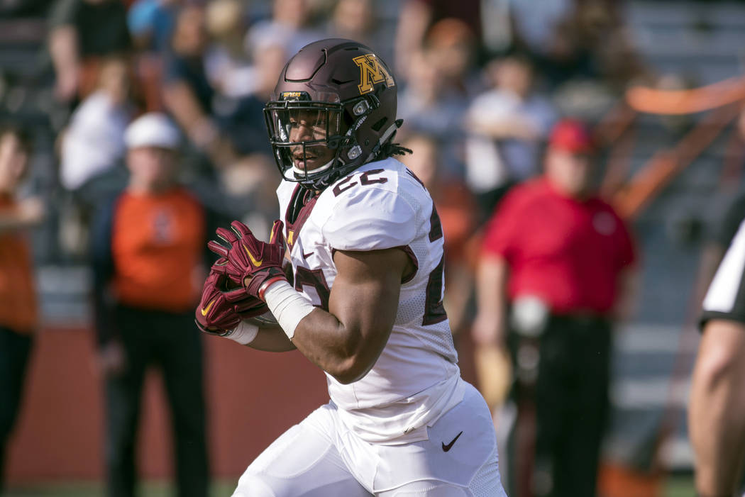 In this Saturday, Oct. 29, 2016, file photo, Minnesota running back Kobe McCrary (22) runs the ball for a touchdown during the fourth quarter of an NCAA college football game against Illinois at M ...