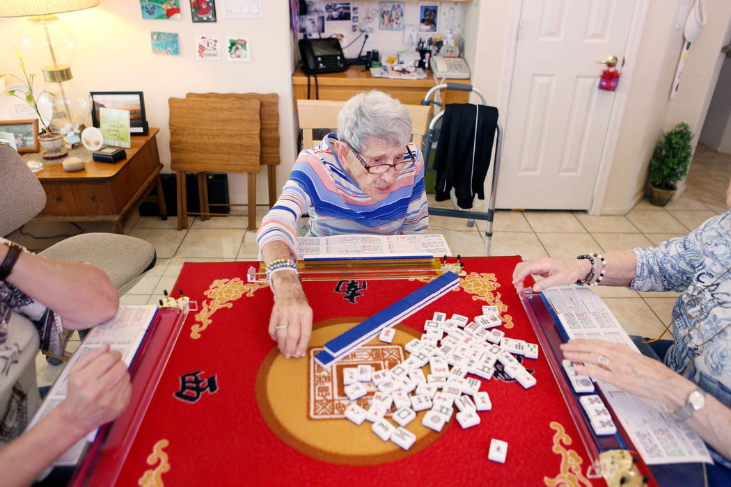 Gladys Stroud, turning 100 March 31,2017, plays the game of mahjong with friends in her home in Las Vegas,  Wednesday, March 22, 2017. (Elizabeth Brumley/Las Vegas Review-Journal) @EliPagePhoto