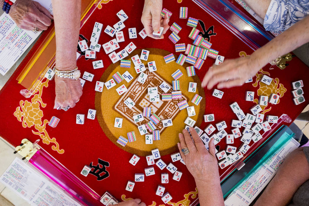 The game of mahjong is played at the home of Gladys Stroud, who turns 100 on March 31, 2017, in Las Vegas,  Wednesday, March 22, 2017. (Elizabeth Brumley/Las Vegas Review-Journal) @EliPagePhoto