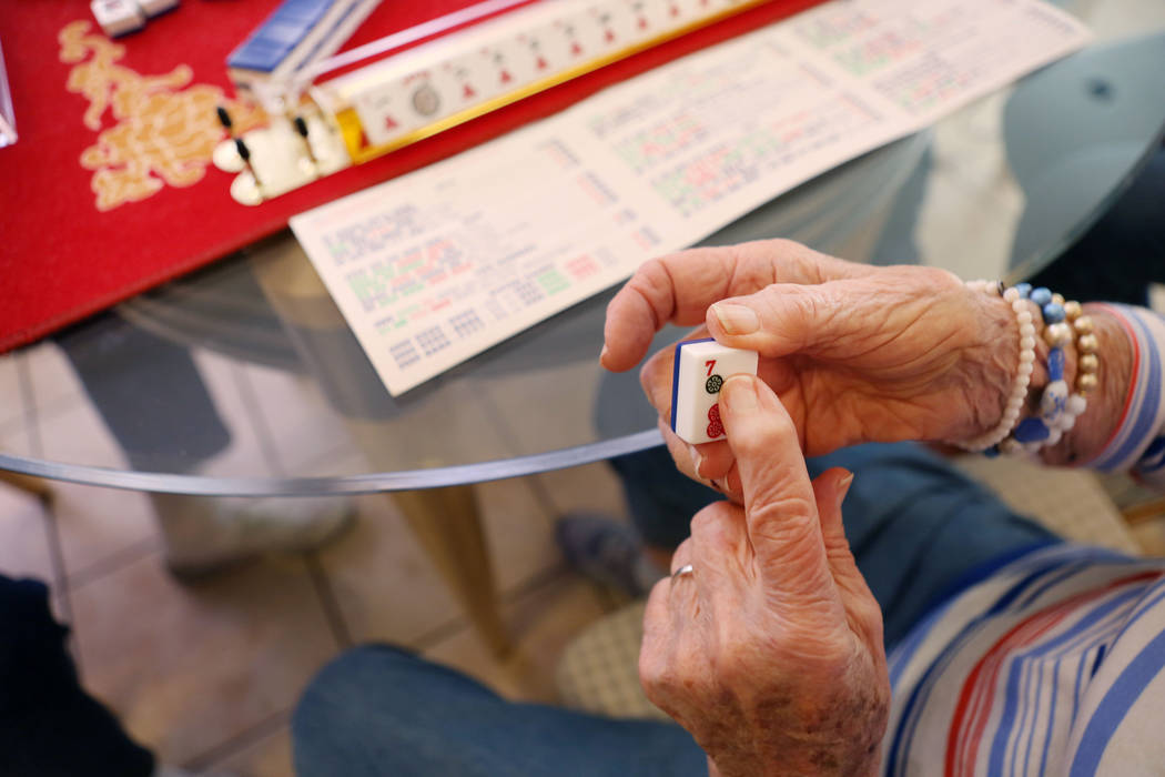 Gladys Stroud, turning 100 March 31,2017, plays the game of mahjong in her home in Las Vegas,  Wednesday, March 22, 2017. (Elizabeth Brumley/Las Vegas Review-Journal) @EliPagePhoto