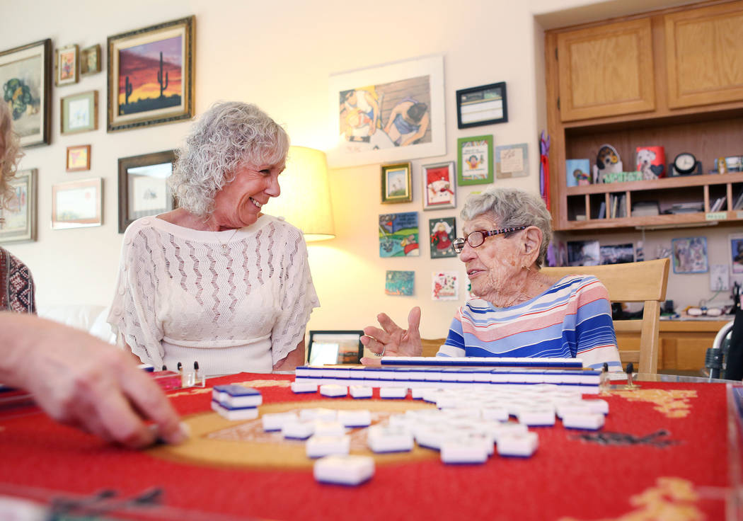 Dianne Zumbo, left, and Gladys Stroud, turning 100 March 31,2017, play the game of mahjong in Stroud's home in Las Vegas,  Wednesday, March 22, 2017. (Elizabeth Brumley/Las Vegas Review-Journal) @ ...
