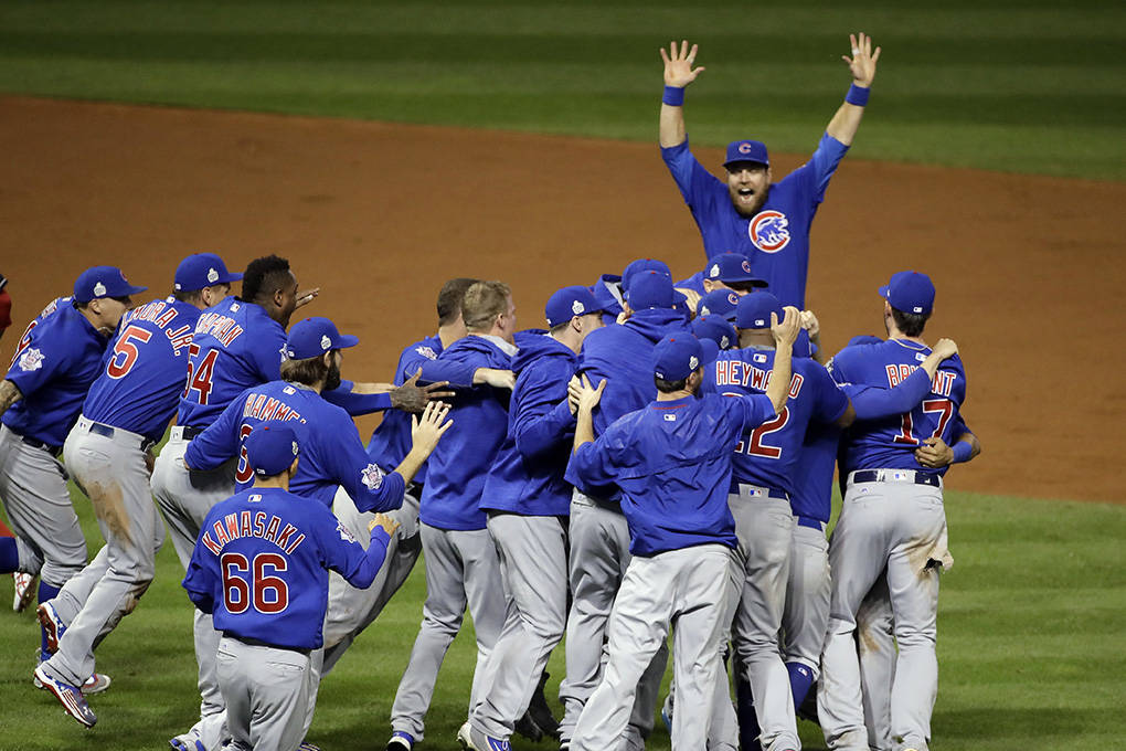 The Chicago Cubs celebrate after Game 7 of the Major League Baseball World Series against the Cleveland Indians Thursday, Nov. 3, 2016, in Cleveland. The Cubs won 8-7 in 10 innings to win the seri ...