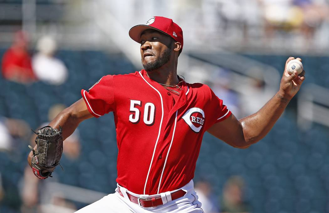 Cincinnati Reds starting pitcher Amir Garrett throws a pitch during the first inning of a spring training baseball game against the Los Angeles Angels Wednesday, March 8, 2017, in Goodyear, Ariz.  ...