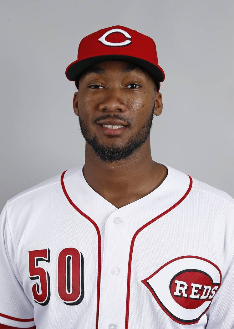 Cincinnati Reds pitcher Amir Garrett poses for a picture during the team's photo day at the Reds baseball spring training facility Saturday, Feb. 18, 2017, in Goodyear, Ariz. (AP Photo/Ross D. Fra ...