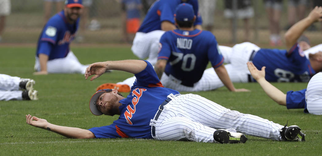 New York Mets' David Roseboom stretches during a spring training baseball workout Tuesday, Feb. 21, 2017, in Port St. Lucie, Fla. (AP Photo/David J. Phillip)