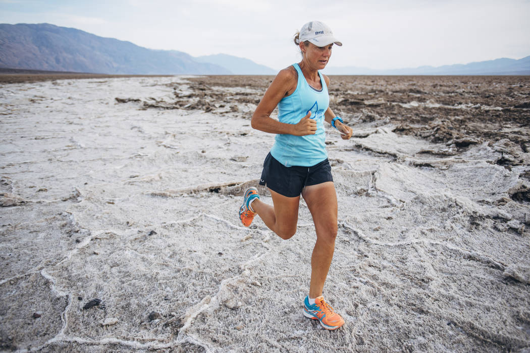Ultra-marathoner and water advocate Mina Guli runs across the Badwater salt flats in Death Valley on March 20, 2016. The 46-year-old from Australia will embark from the Springs Preserve Wednesday  ...