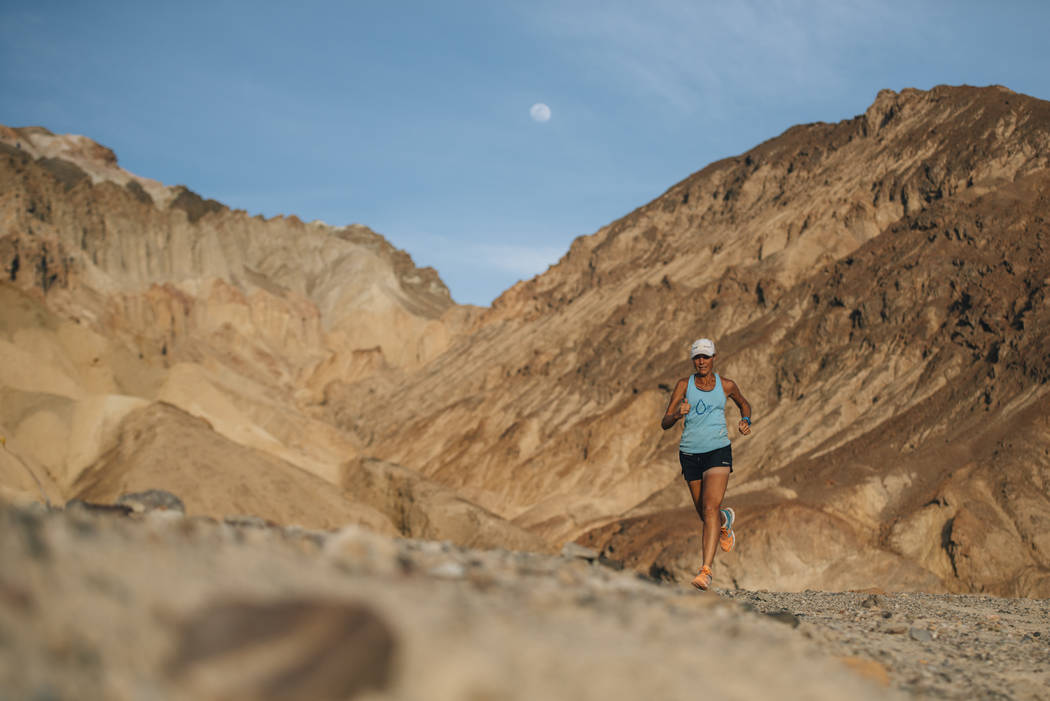 Ultra-marathoner and water advocate Mina Guli runs through Golden Canyon at Death Valley National Park on March 21, 2016. The 46-year-old from Australia will embark from the Springs Preserve Wedne ...