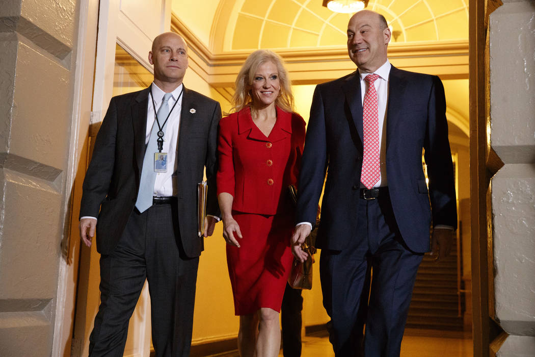 White House Senior Adviser Kellyanne Conway, center, and National Economic Council director Gary Cohn arrive for a meeting on Capitol Hill in Washington, Tuesday, March 21, 2017, between President ...