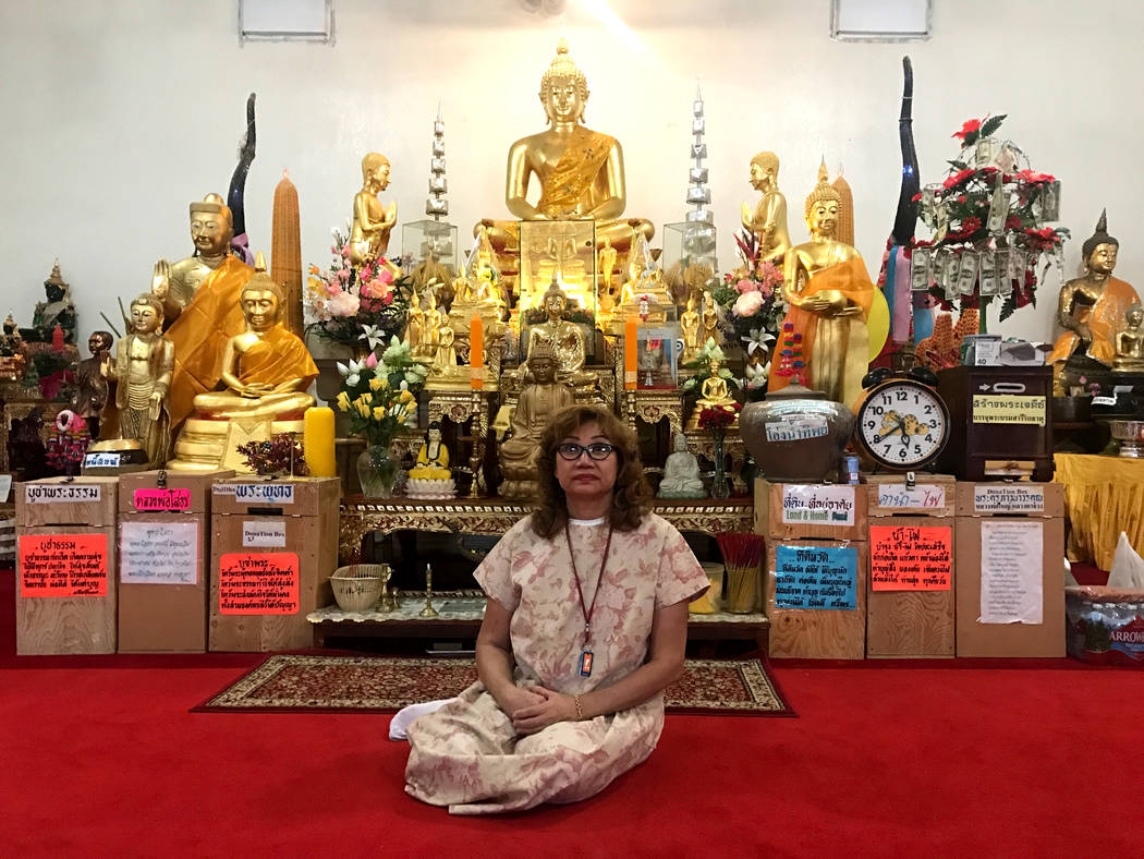 Arunee Price sits in front of Buddhist statues on March 17, 2017 at the Thai Buddhist Temple Las Vegas. (Kailyn Brown/View) @kailynhype