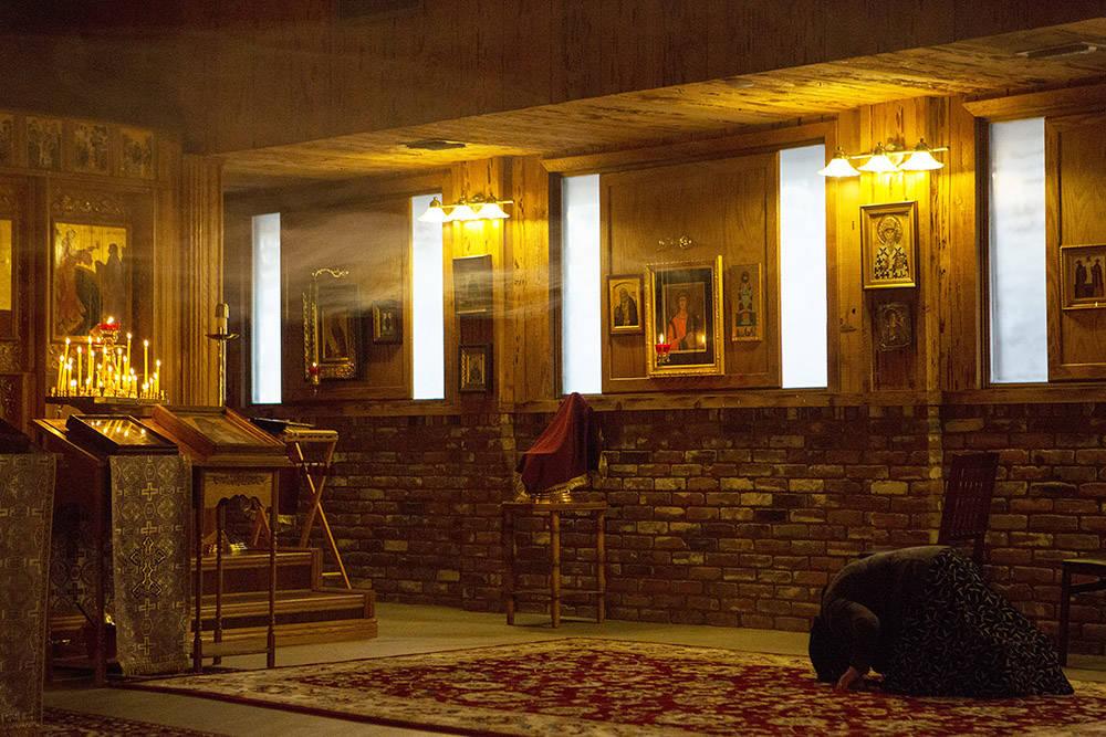 A woman prays while Bishop Nikolai leads a service at All Saints Russian Orthodox Church on Wednesday, March 22, 2017, in Las Vegas. (Bridget Bennett/Las Vegas Review-Journal) @bridgetkbennett