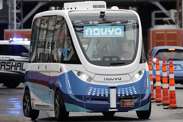The Navya Arma autonomous vehicle drives down a street Jan. 12, 2017, in Las Vegas. The driverless electric shuttle carried passengers in a test program in a downtown Las Vegas entertainment distr ...