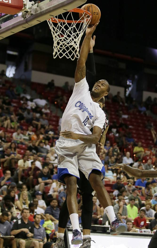 Las Angeles Clippers' Amath M'Baye goes up for a basket against the Miami Heat during the first half of an NBA summer league basketball game Monday, July 14, 2014, in Las Vegas. (AP Photo/John Locher)
