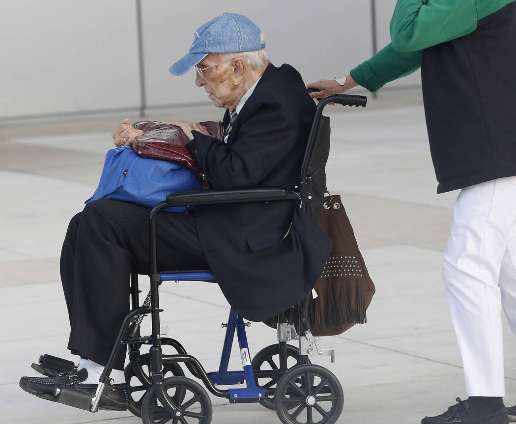 Dr. Henri Wetselaar, 93, charged with money laundering, conspiracy to distribute oxycodone and conspiracy to distribute controlled substances, is wheeled out of the Lloyd D. George United States c ...