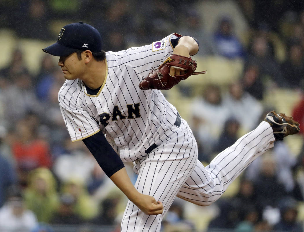 Japan's Tomoyuki Sugano throws during the first inning of a semifinal in the World Baseball Classic against the United States in Los Angeles, Tuesday, March 21, 2017. (AP Photo/Chris Carlson)