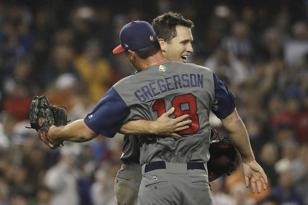 United States' Buster Posey and Luke Gregerson celebrate after the United States defeated Japan, 2-1, in a semifinal in the World Baseball Classic in Los Angeles, Tuesday, March 21, 2017. (AP Phot ...