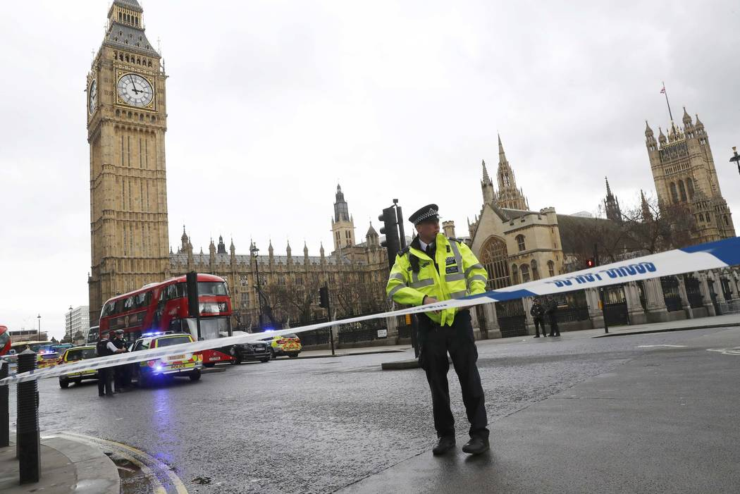 Police tapes off Parliament Square after reports of loud bangs, in London, Britain, March 22, 2017. (Stefan Wermuth/Reuters)