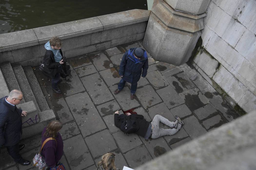 A man lies injured after a shottingt incident on Westminster Bridge in London, March 22, 2017.  REUTERS/Toby Melville