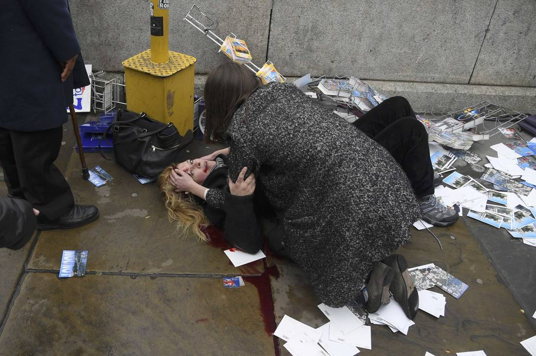 A woman lies injured after a shotting incident on Westminster Bridge in London, March 22, 2017. (Toby Melville/Reuters)