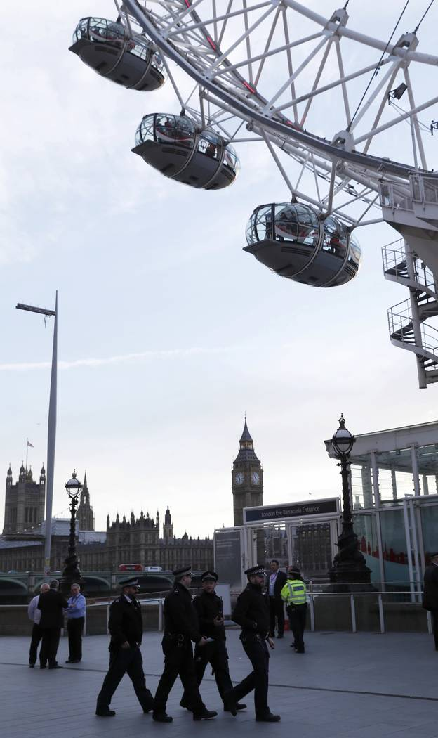 Police officers stand by as people are seen inside the pods on the London Eye after it was stopped following an attack on Westminster Bridge in London, Britain March 22, 2017. (Eddie Keogh/Reuters)