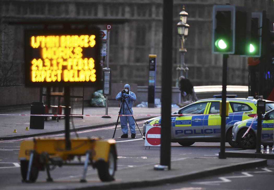 A forensics investigator works at the scene after an attack on Westminster Bridge in London, Britain March 22, 2017. (Hannah McKay/Reuters)