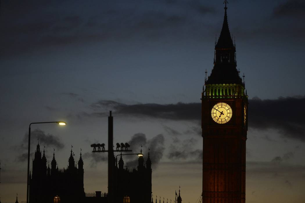 The sun sets behind the Houses of Parliament after an attack on Westminster Bridge in London, Britain March 22, 2017. (Hannah McKay/Reuters)