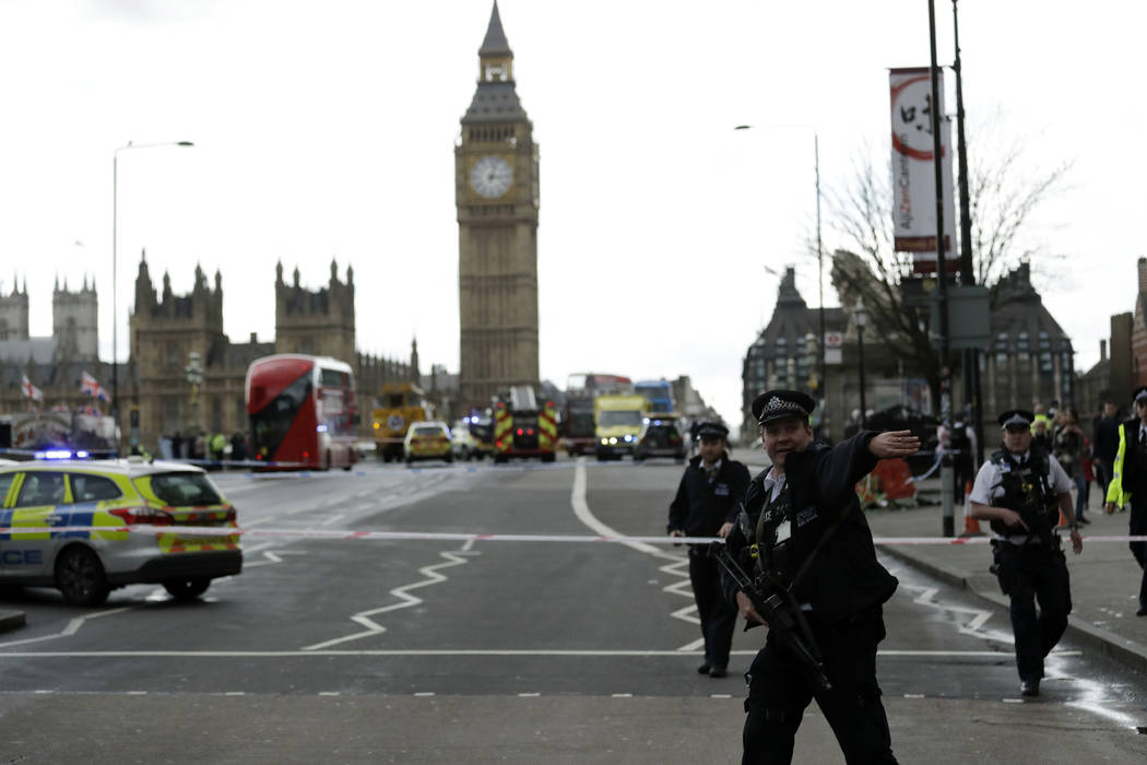 Police secure the area on the south side of Westminster Bridge close to the Houses of Parliament in London, Wednesday, March 22, 2017. (Matt Dunham/AP)
