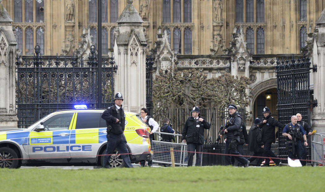 Police on the scene after sounds similar to gunfire have been heard close to the Houses of Parliament, London, Wednesday, March 22, 2017. London police say officers called to 'firearms incident' o ...
