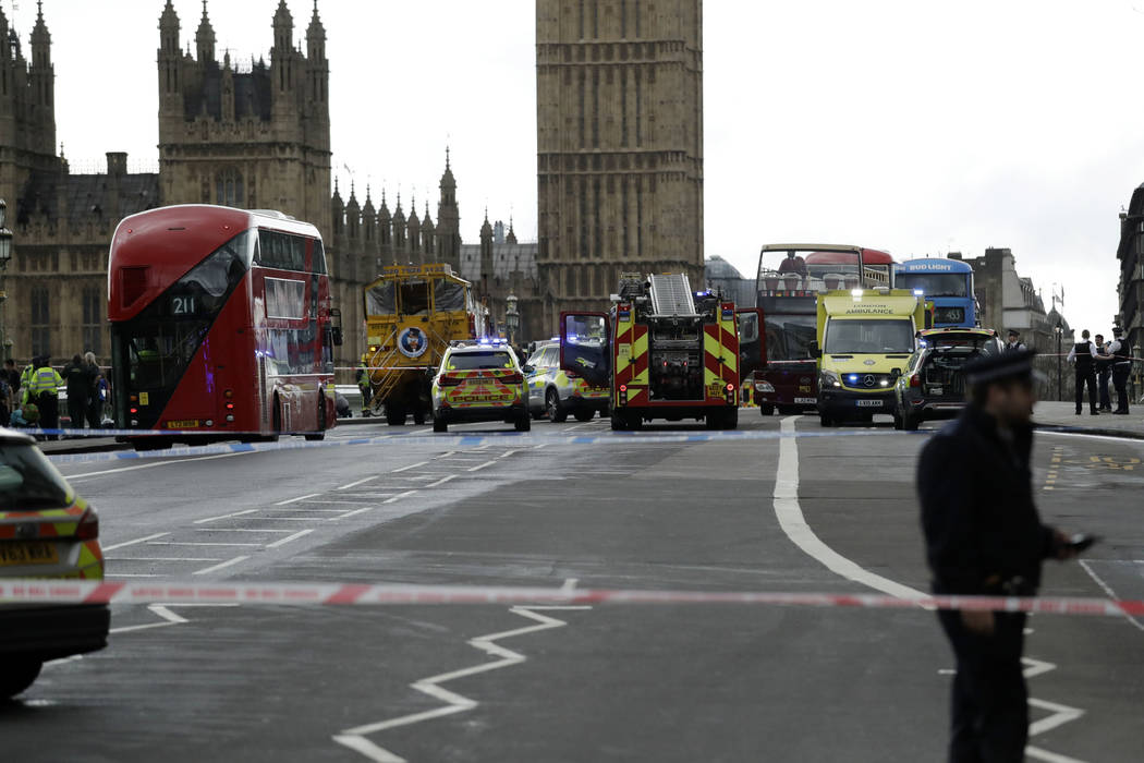 Police secure the area on the south side of Westminster Bridge close to the Houses of Parliament in London, Wednesday, March 22, 2017. The leader of Britain's House of Commons says a man has been  ...